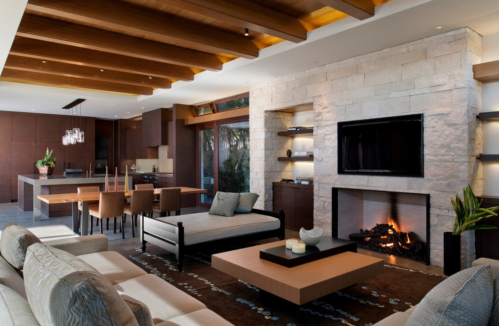Living room - contemporary open concept living room idea in Orange County with a standard fireplace, a wall-mounted tv and a stone fireplace