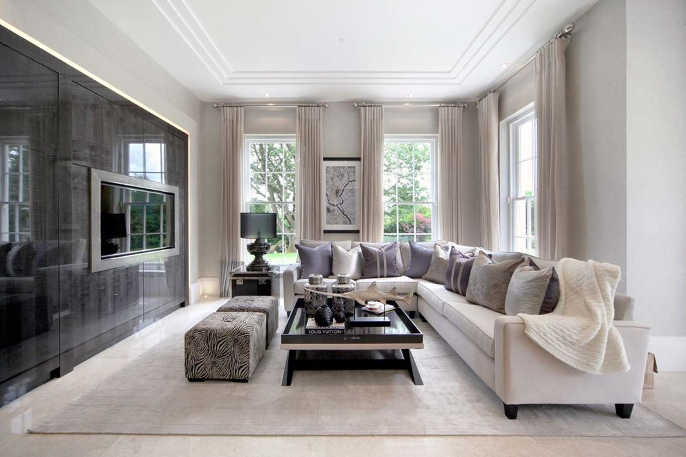 Mid-sized trendy formal living room photo in Surrey with gray walls and a wall-mounted tv
