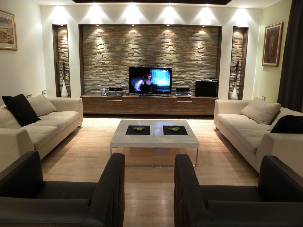Living room - contemporary beige floor living room idea in Other with a tv stand