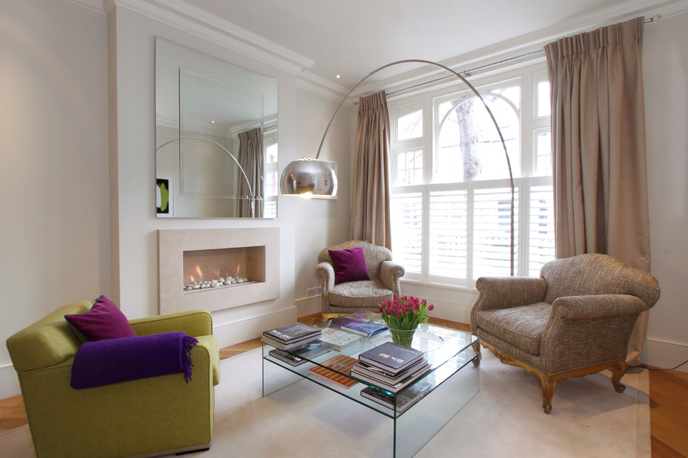 Inspiration for a mid-sized contemporary living room remodel in London with white walls, a ribbon fireplace and no tv