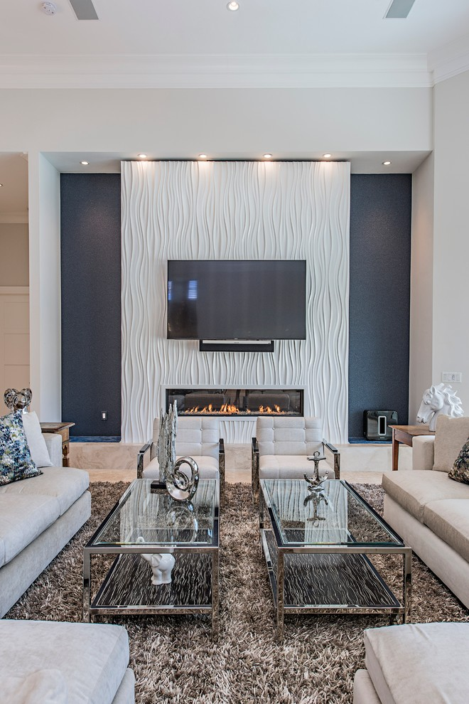 Inspiration for a contemporary living room remodel in Tampa with blue walls, a ribbon fireplace and a wall-mounted tv