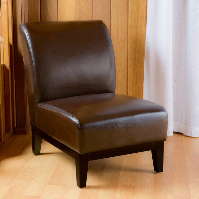contemporary living space with brown slipper accent chair