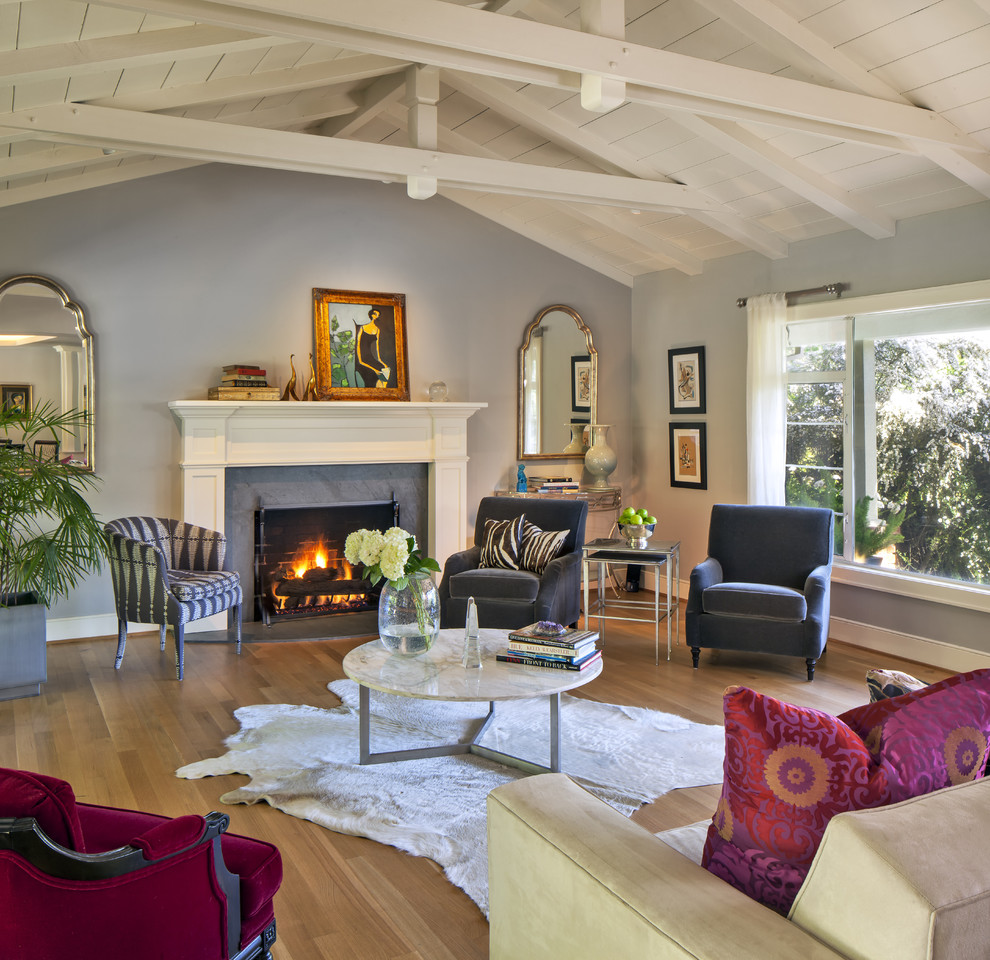 Living room - eclectic living room idea in San Francisco with blue walls and a standard fireplace