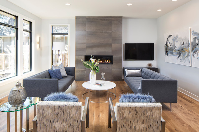 Inspiration for a mid-sized contemporary formal and open concept light wood floor living room remodel in Minneapolis with a ribbon fireplace, a tile fireplace and a wall-mounted tv