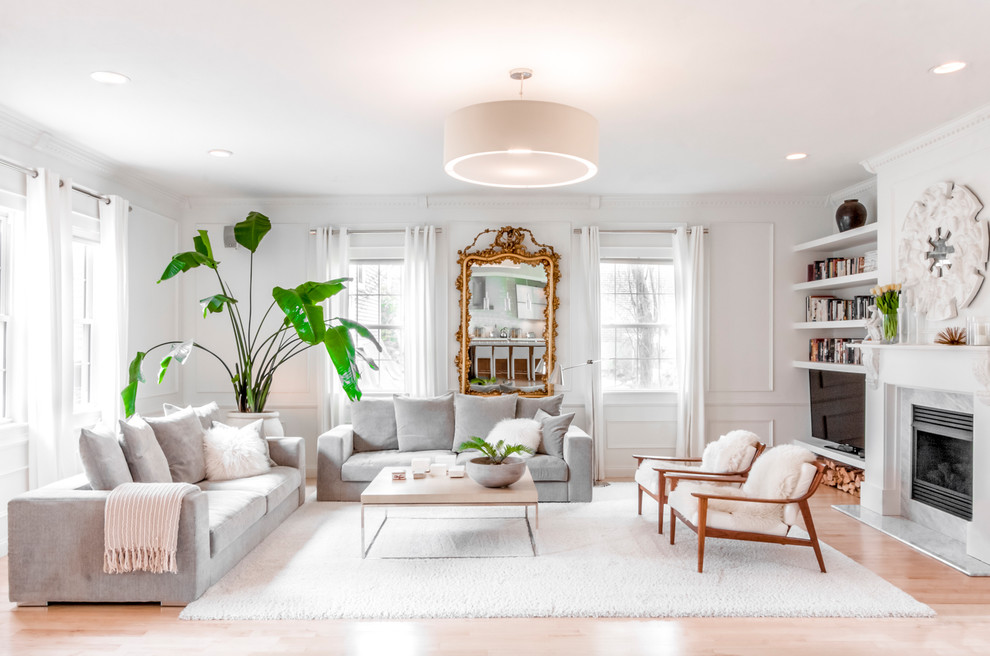 Living room - transitional light wood floor and beige floor living room idea in Boston with white walls, a standard fireplace and a tv stand
