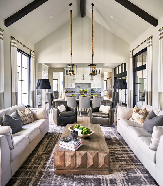 Example of a transitional open concept carpeted and gray floor living room design in Other with gray walls