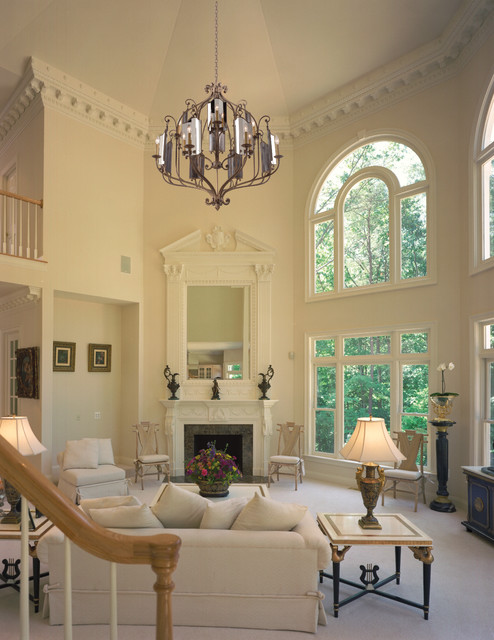 Inspiration for a timeless formal living room remodel in Miami with a standard fireplace