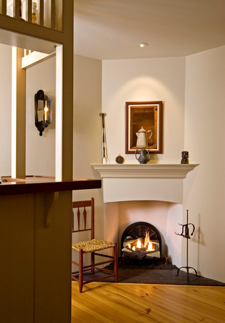 Corner fireplace and tavern bar traditional living for Building a corner fireplace