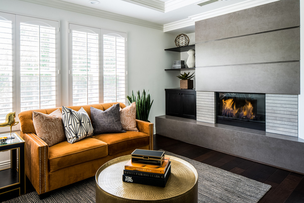 Inspiration for a transitional dark wood floor and brown floor living room remodel in Orange County with white walls and a ribbon fireplace