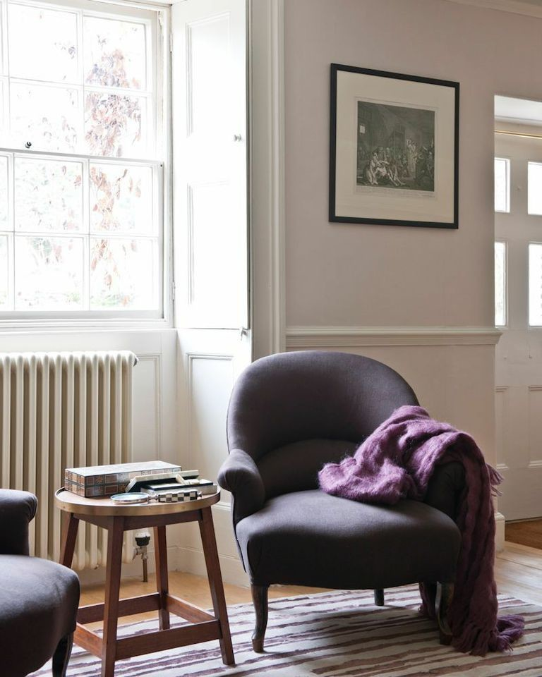 Mid-sized country living room photo in London
