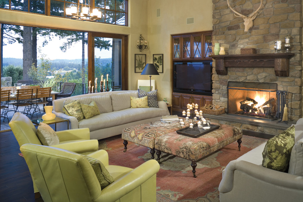 Example of a classic living room design in Portland with a stone fireplace
