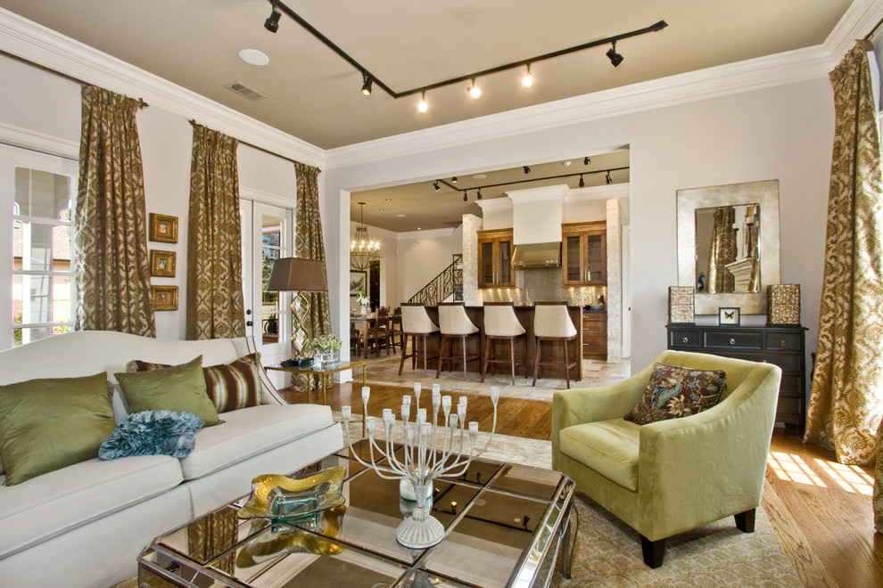 Example of a trendy medium tone wood floor living room design in New Orleans with white walls