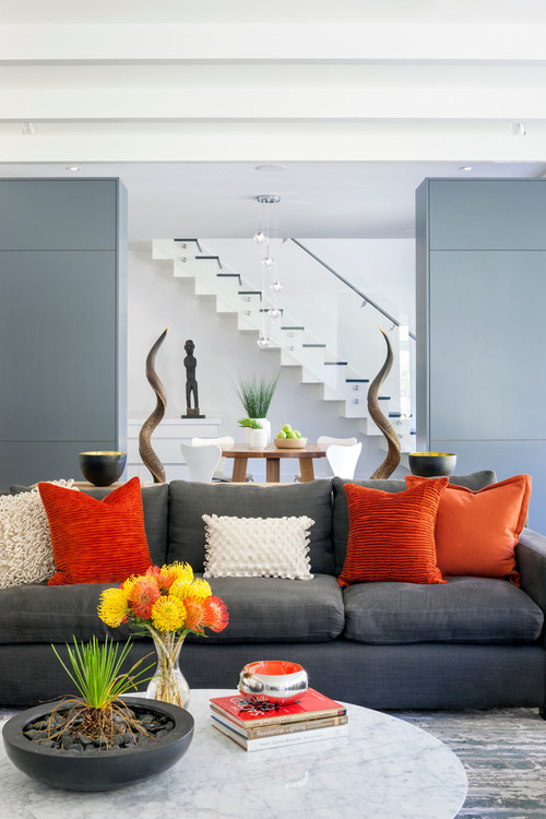Gray sofa accented with orange pillows