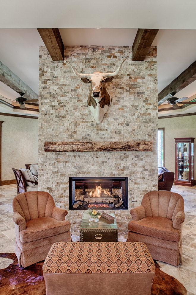 Example of a mountain style living room design in Other with a two-sided fireplace