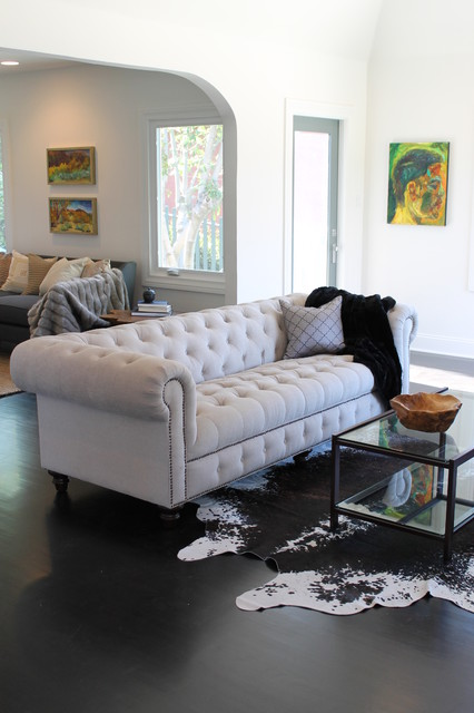 cowhide rug and linen chesterfield sofa - eclectic - living room