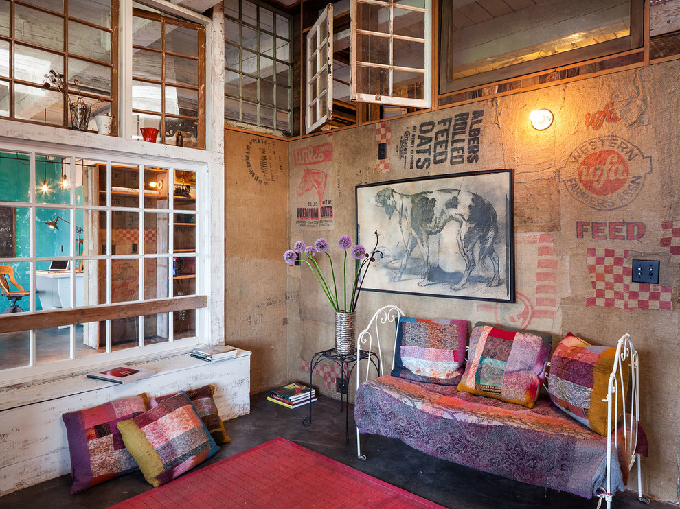 Example of an eclectic concrete floor living room design in Portland with multicolored walls, no fireplace and no tv