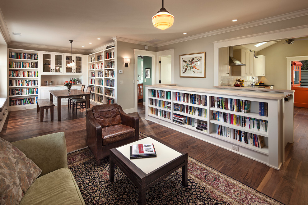 Living room library - small craftsman open concept dark wood floor living room library idea in Santa Barbara with no fireplace