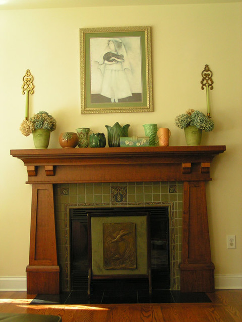 A beautiful wood stained and lacquered Craftsman mantle. The lovely green Craftsman style tiles are a great compliment to the mantel.