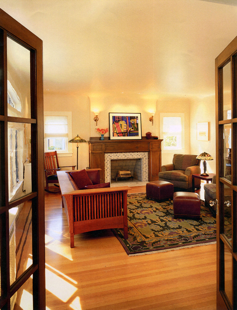 Arts and crafts living room photo in Seattle with a tile fireplace