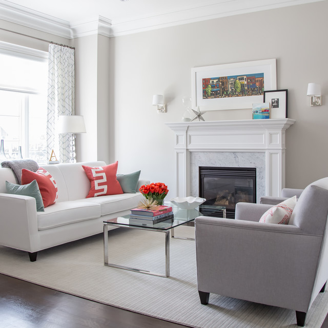 Inspiration for a mid-sized contemporary formal and open concept medium tone wood floor living room remodel in Toronto with white walls, a standard fireplace, a stone fireplace and no tv