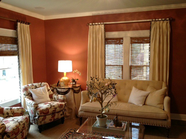 Cream silk curtain panels with trim down leading edge traditional living room nashville for Terracotta living room ideas