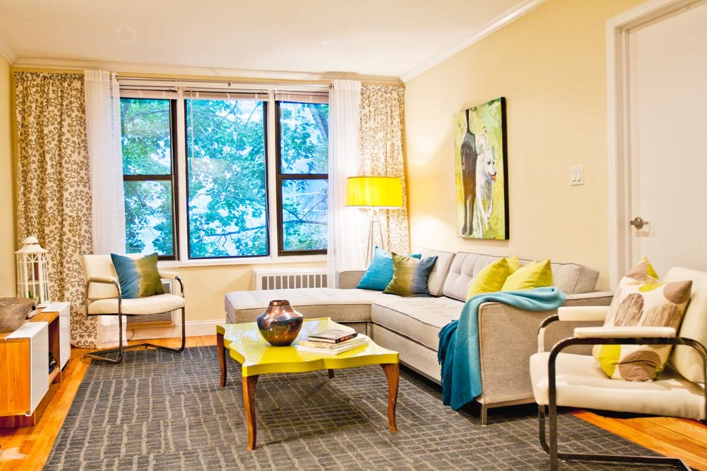 Inspiration for a mid-sized modern medium tone wood floor living room remodel in New York with beige walls