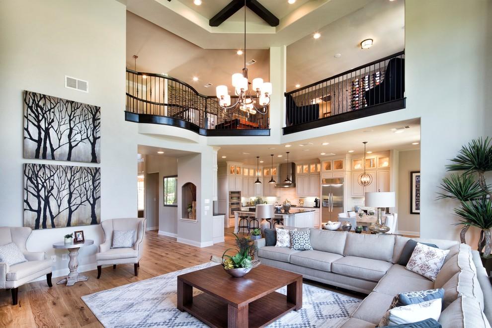 Living room - transitional open concept light wood floor living room idea in Philadelphia with beige walls