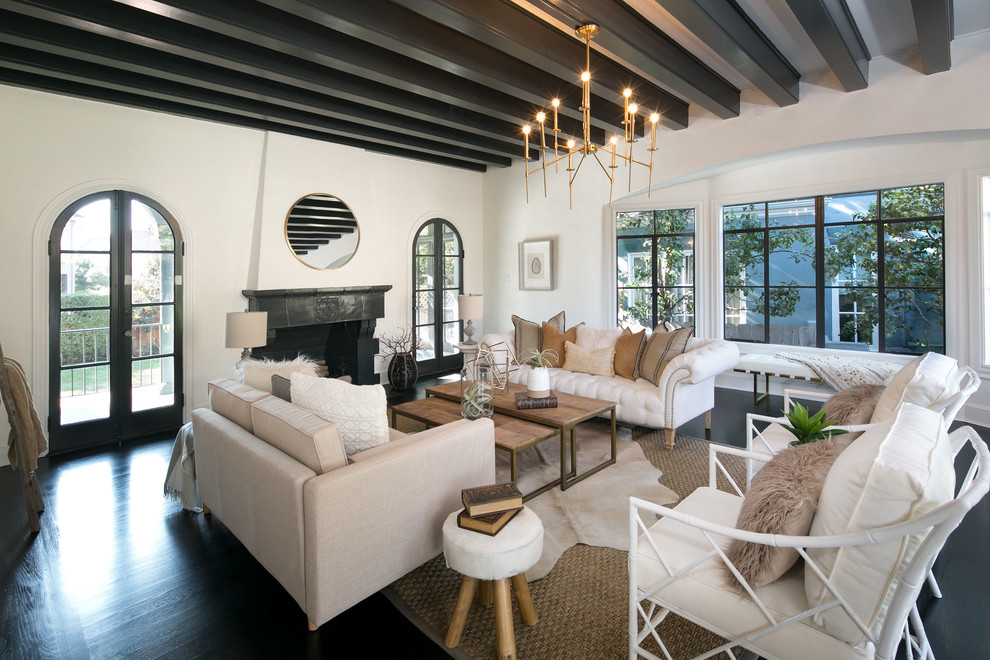 Inspiration for a large mediterranean formal and enclosed dark wood floor and black floor living room remodel in San Francisco with white walls, a standard fireplace, a tile fireplace and no tv