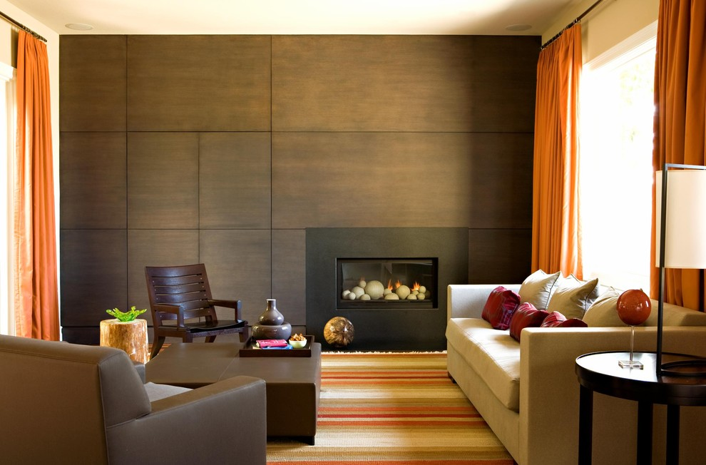 Living room - contemporary living room idea in Los Angeles with brown walls and a standard fireplace