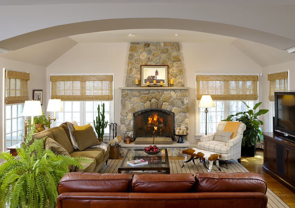 Inspiration for a contemporary living room remodel in New York with a stone fireplace