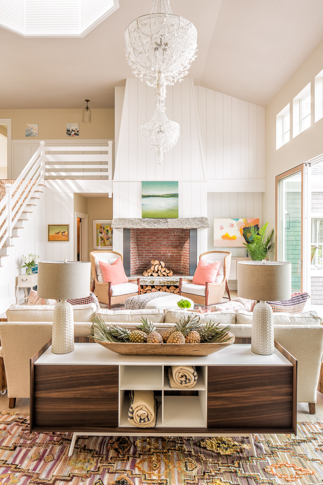 Beach style open concept living room photo in Portland Maine with white walls