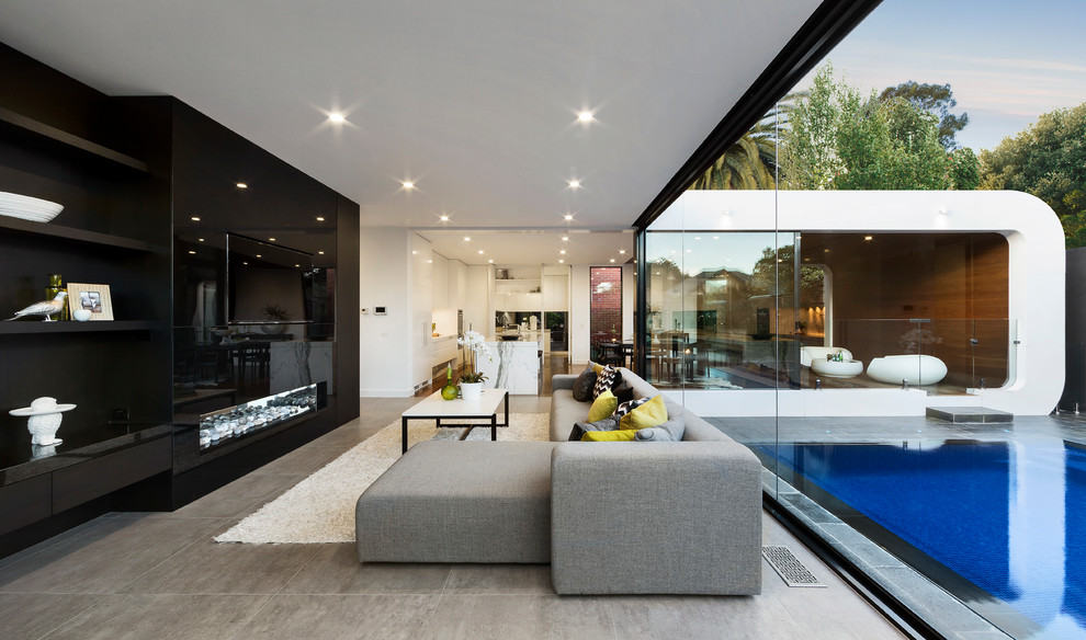 Mid-sized trendy open concept living room photo in Melbourne with a ribbon fireplace, a wall-mounted tv and black walls