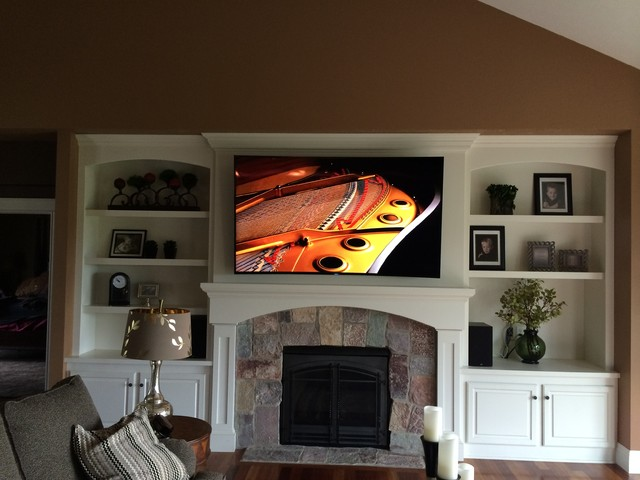 Curved Television Mount Above Fireplace Transitional
