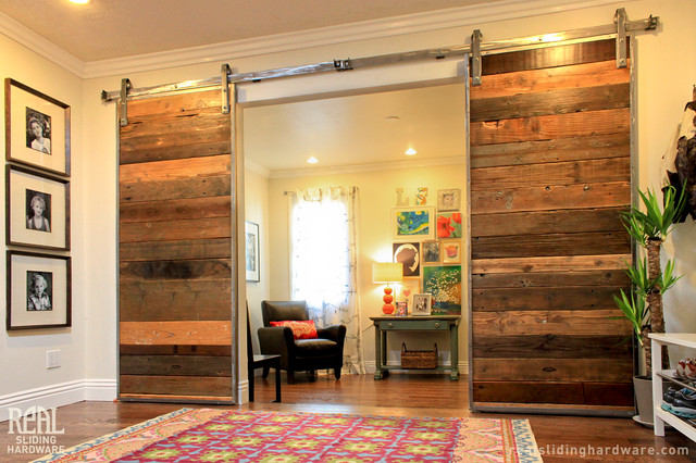 custom barn door with stainless steel barn door hardware On living room 4 doors