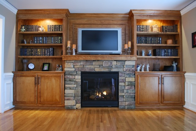 Custom built in cabinets and stone surround fireplace for Living room cabinets