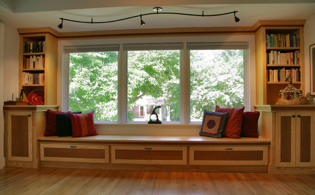 Custom cabinets, window seat and s-curved track light ...