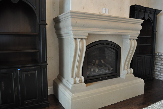Cast stone fireplace surround that wraps around wall pop out wit corbel legs.