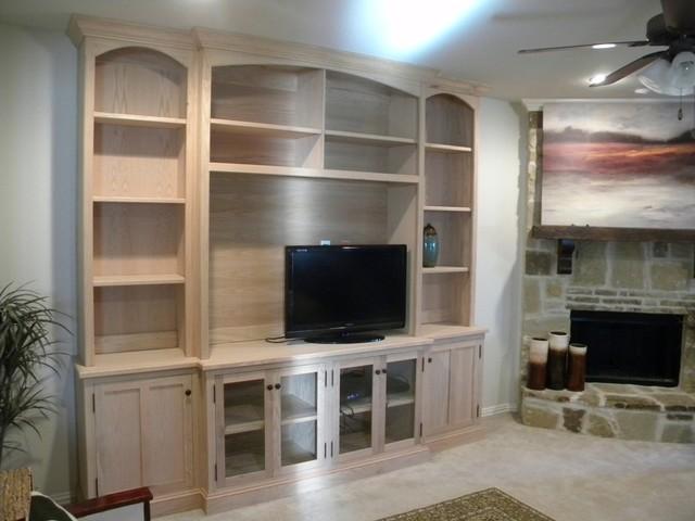 Custom entertainment centers traditional living room for Living room entertainment