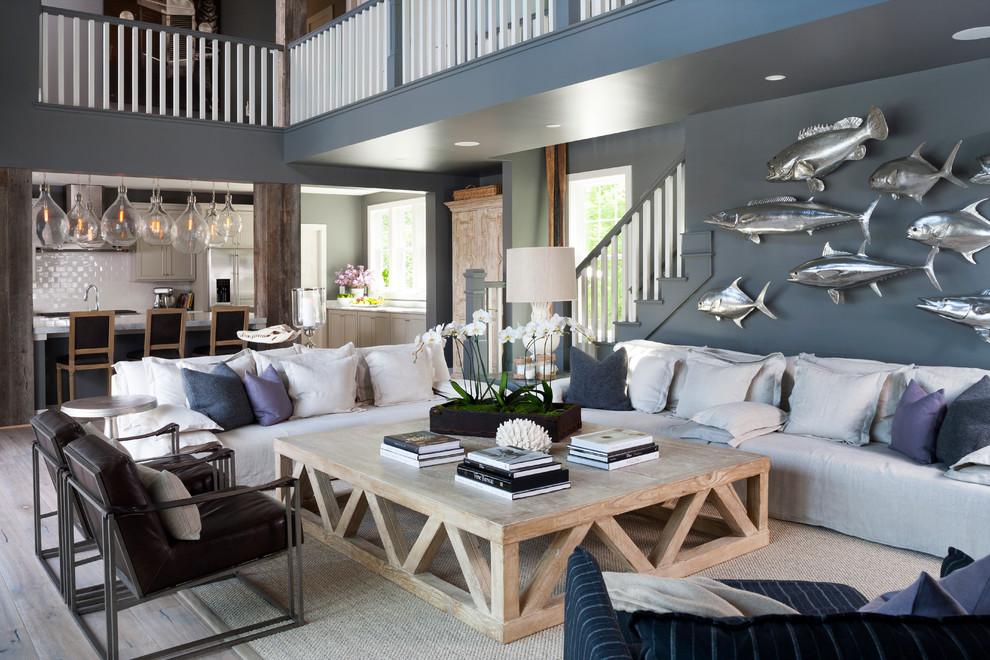 Living room - coastal open concept light wood floor living room idea in DC Metro with blue walls