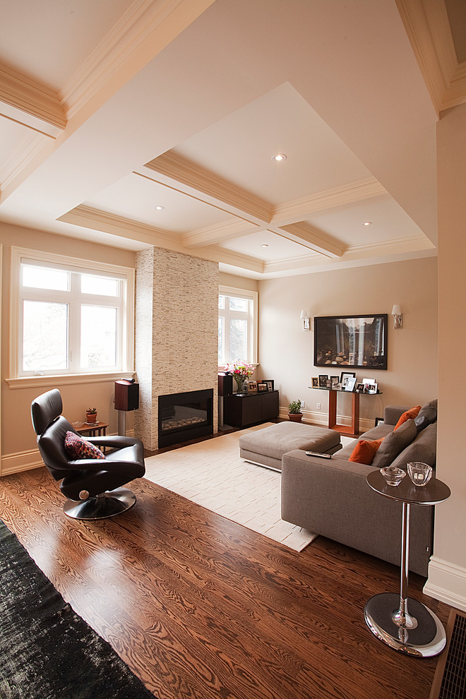 Living room - contemporary living room idea in Toronto with beige walls and a standard fireplace