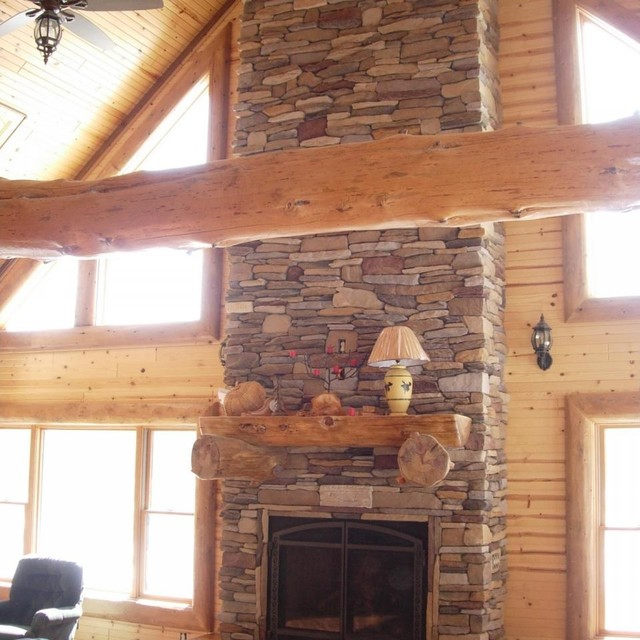 Custom michigan log home during costruction traditional-living-room