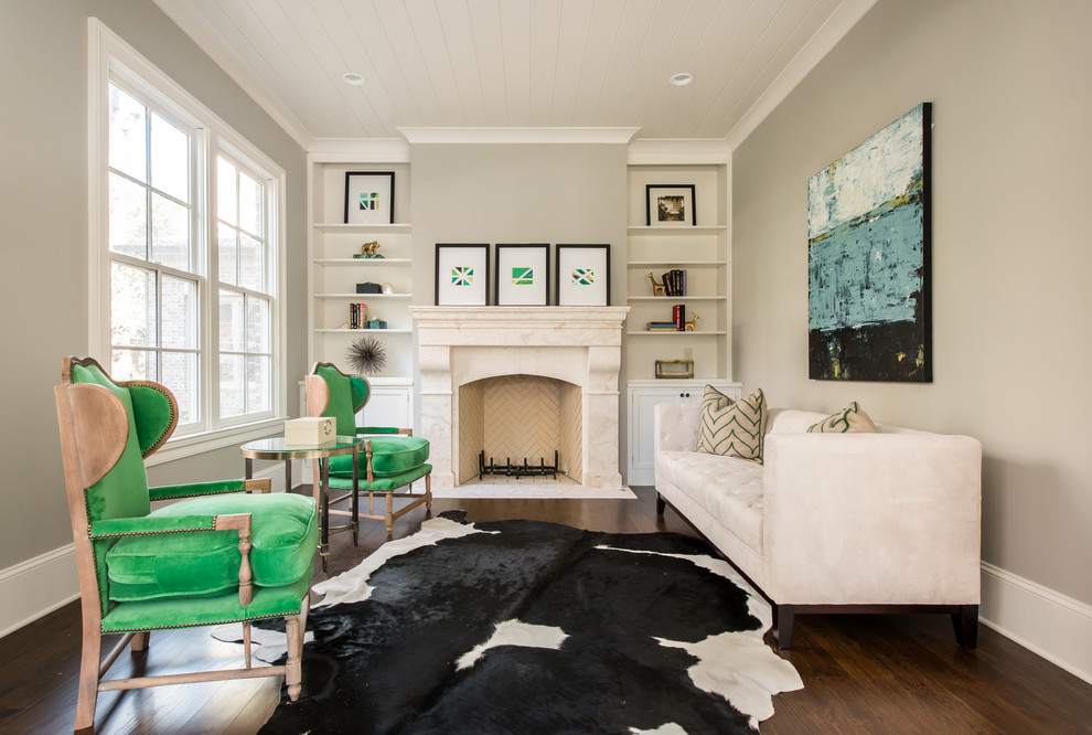 Inspiration for a transitional formal dark wood floor living room remodel in Atlanta with beige walls and a standard fireplace