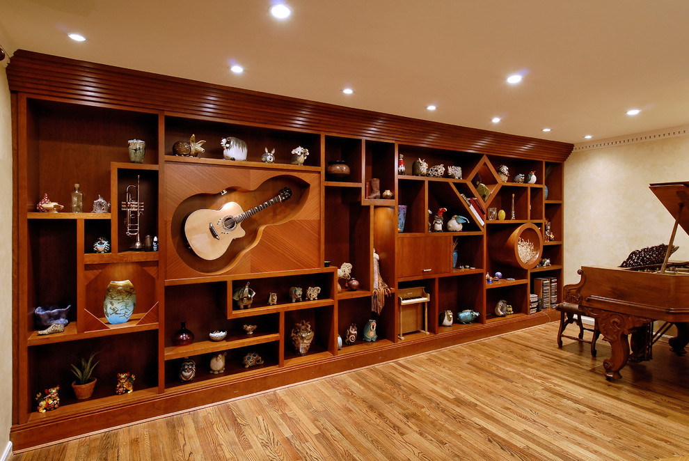 Example of a mid-sized eclectic enclosed light wood floor living room design in DC Metro with a music area, beige walls and no tv