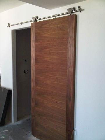 Custom Walnut Barn Door W/ Track Contemporary Living Room