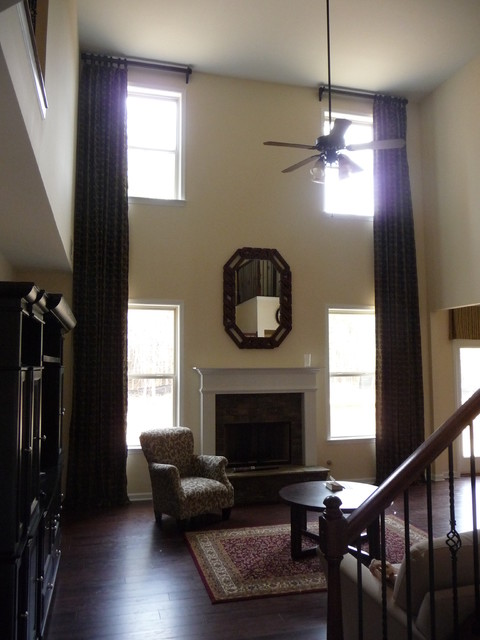 Custom window treatments two story traditional living room atlanta by next level interiors for Traditional window treatments living room