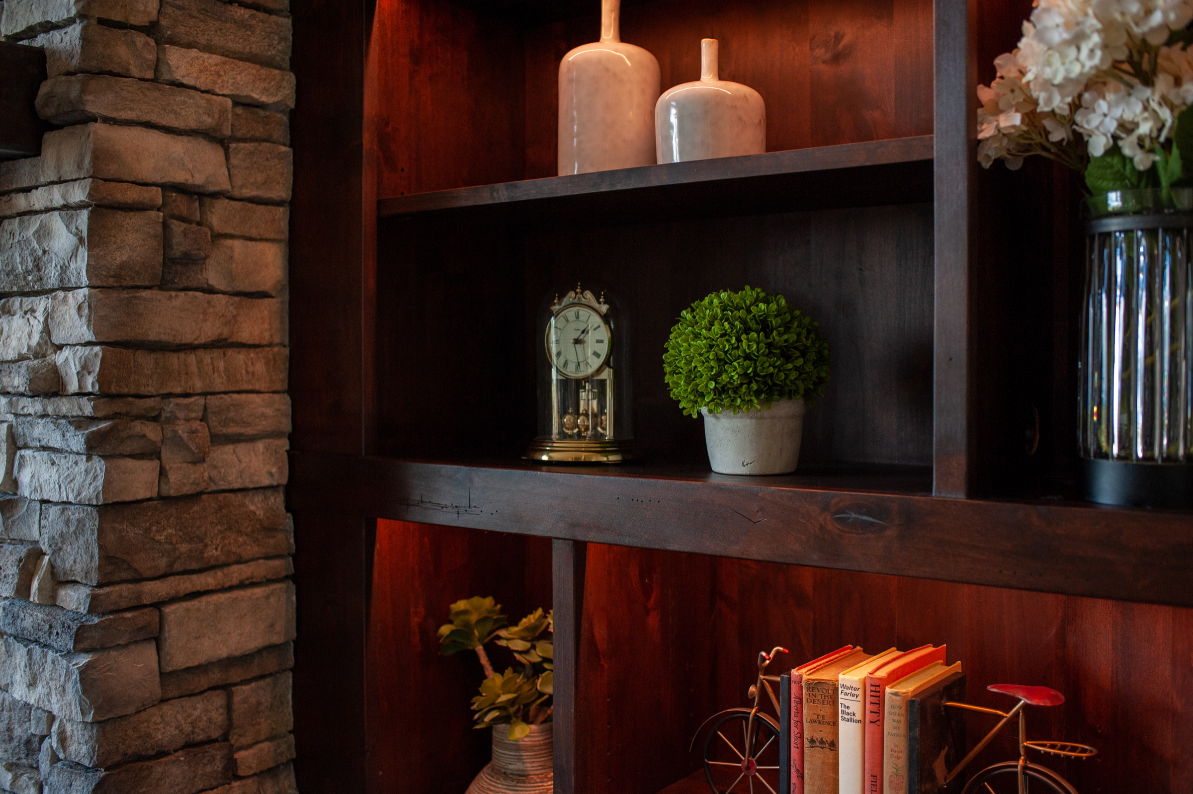 Custom Woodwork, Cabinets with Granite Countertops and Fireplace Hearth