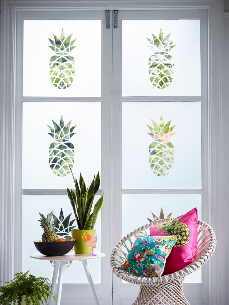Inspiration for a tropical living room remodel in Buckinghamshire with white walls
