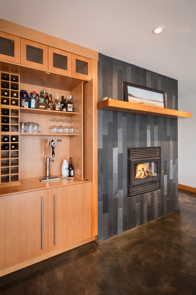 Inspiration for a contemporary concrete floor living room remodel in Vancouver with a bar and a tile fireplace