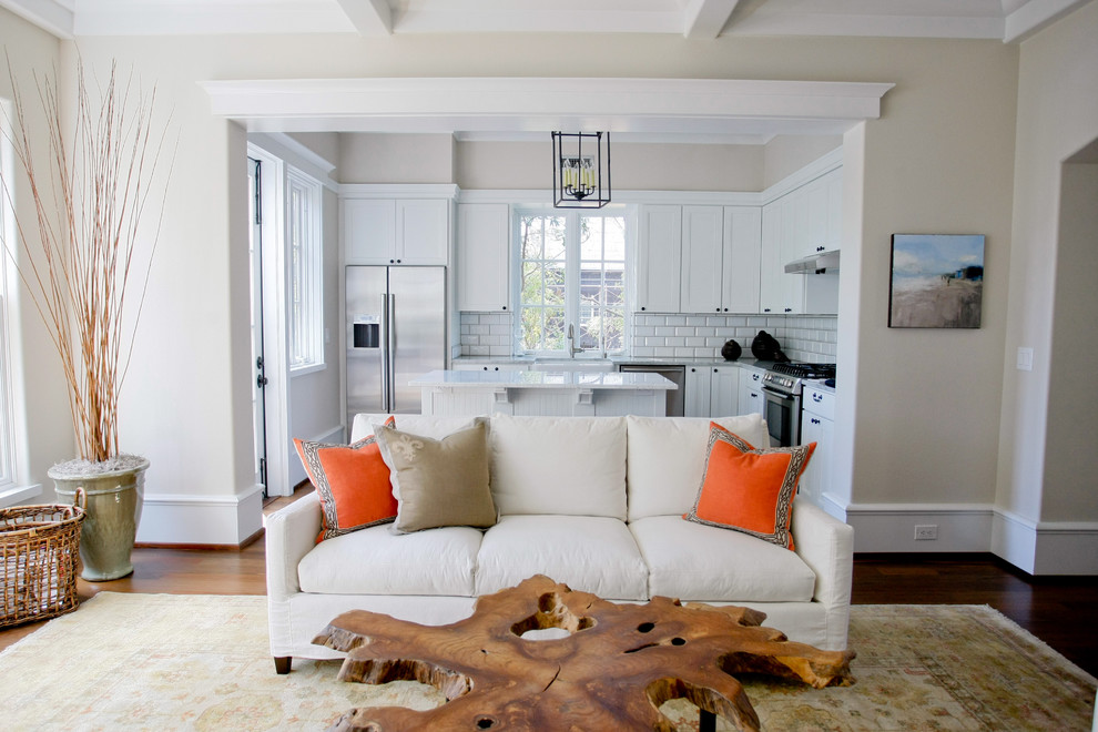 Example of a classic living room design in Charleston with beige walls