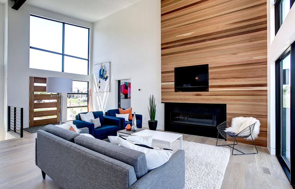 Mid-sized trendy open concept and formal light wood floor living room photo in Grand Rapids with white walls, a ribbon fireplace, a wall-mounted tv and a wood fireplace surround